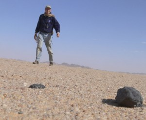 Peter Jenniskens in Sudan with some of the meteorites (NASA)
